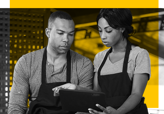 restaurant workers using hr management software on tablet